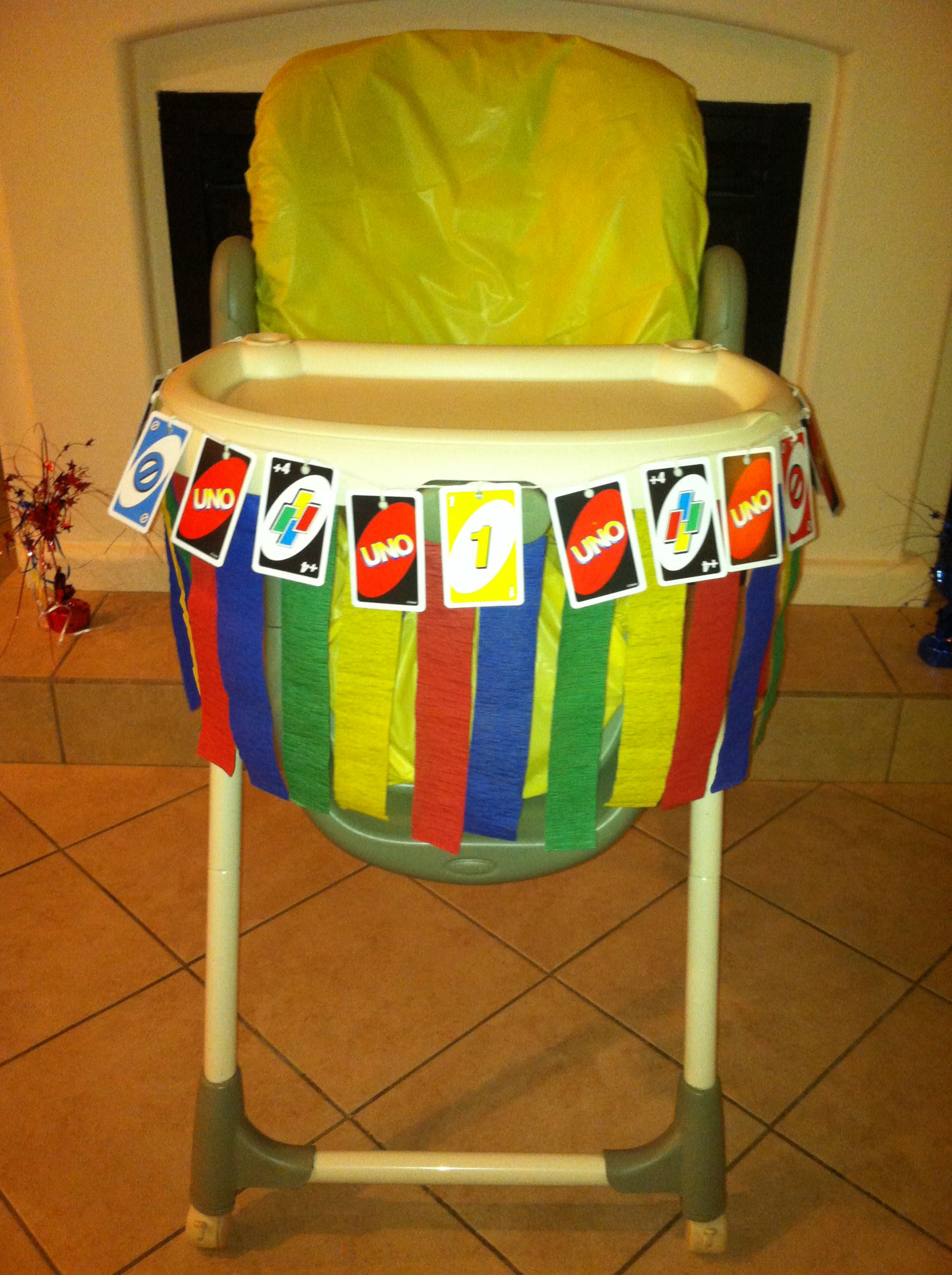 Uno theme high chair decor! Plastic table cloth to cover