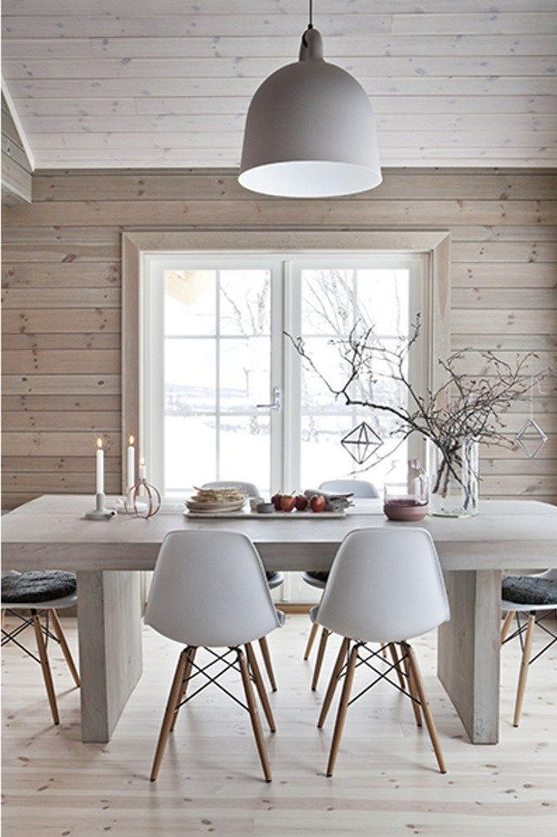The softening of the wood with a light wash of white stain creates a contemporary feel compared to the yellow/brown of typical wood used in cabins