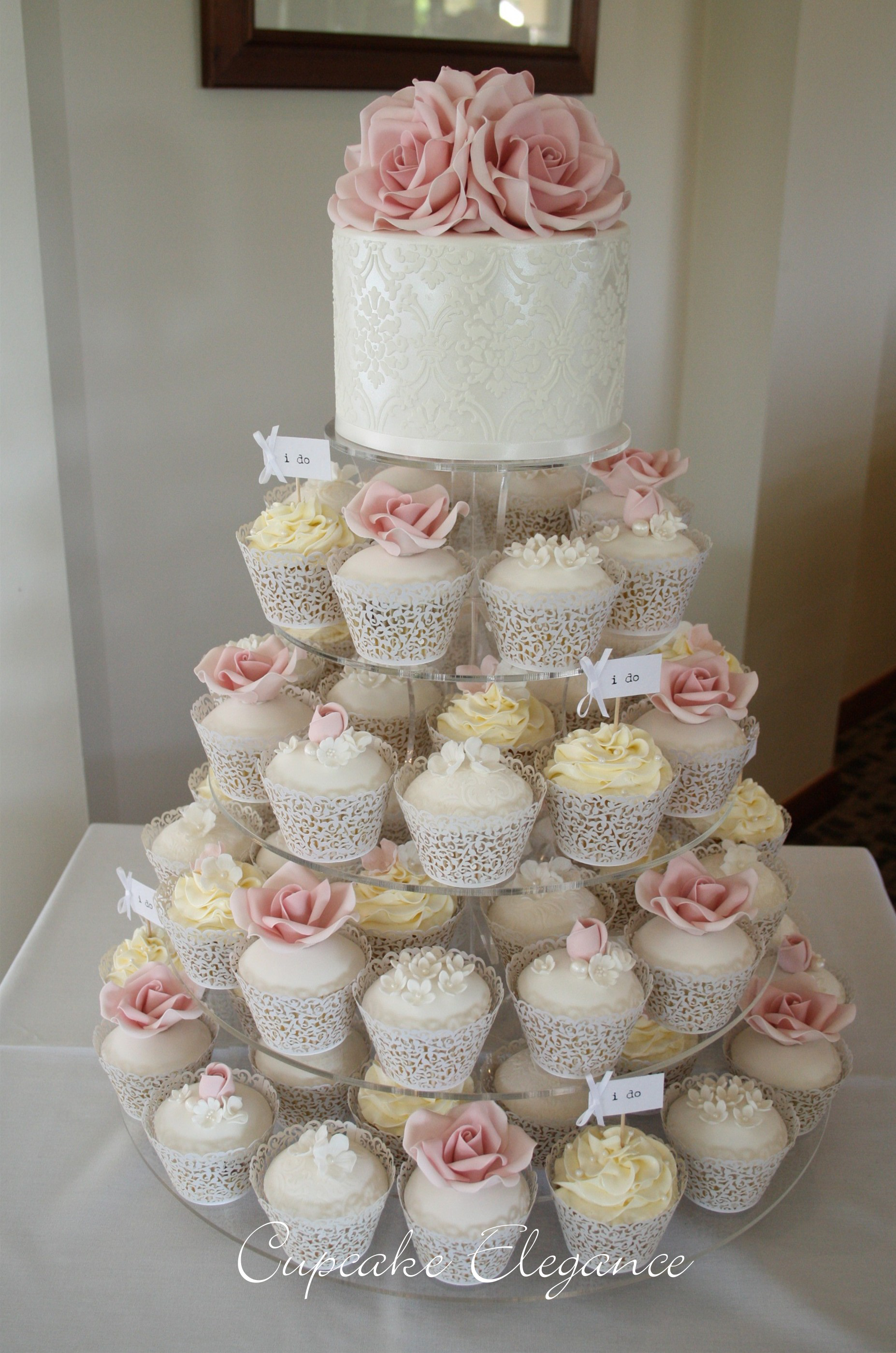 Wedding cake ideas soft pink roses with pearls and lace
