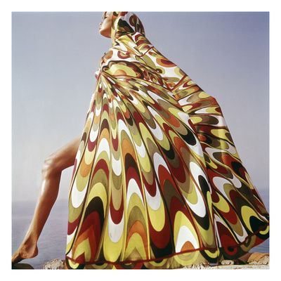 Published January 1, 1965    Under Vogue editor Diana Vreeland, Henry Clarke broke the mold of Fifties-era, black and white propriety with powerfully alive images like this iconic photograph of Veruschka from the January 1, 1965, Vogue. The famed model strikes a dramatic pose in a kaleidoscopic, hooded Emilio Pucci caftan on the shore of Lake Tanganyika in Tanzania.