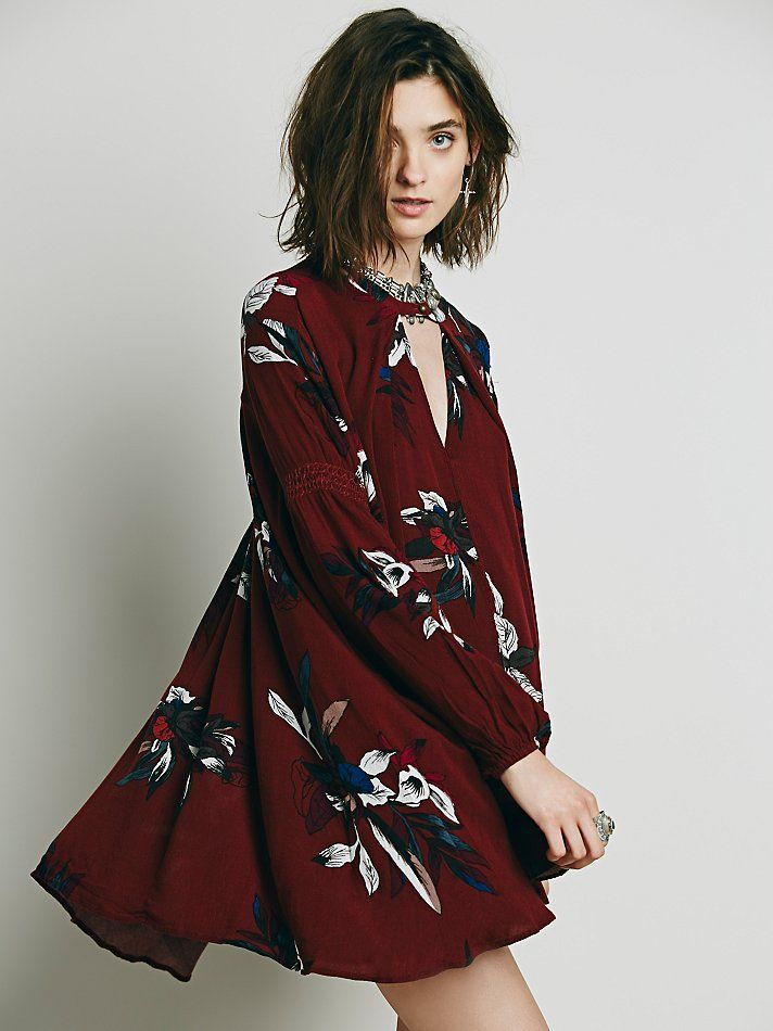 d1ad293376d82 Electric Orchid Print Swing Tunic | Printed swing tunic with an exploded  floral print; features keyhole opening at the bust and pockets below waist.