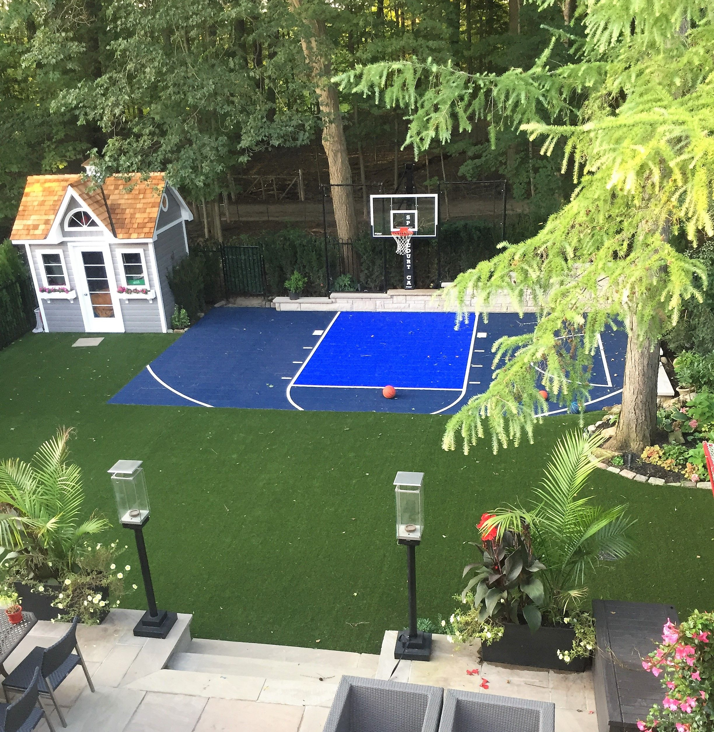 New Sports Court Shed And Full Turf Application Hockey Basketball And Soccer On The Turf Gas Torches Basketball Court Backyard Backyard Basketball Backyard Backyard landscaping ideas with basketball court