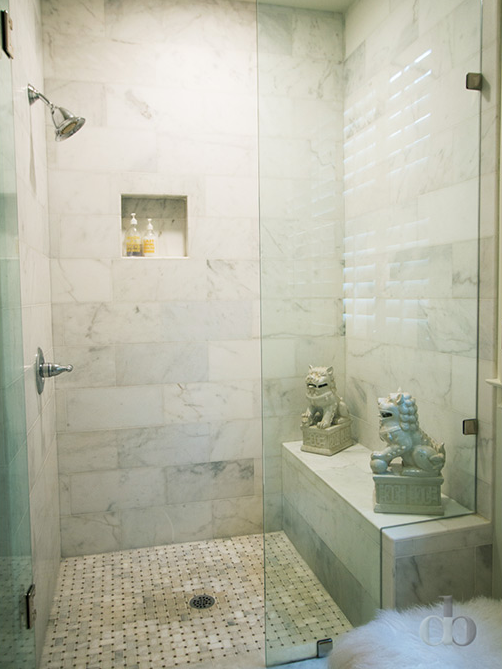 Chic walk in shower features walls clad in oversize marble subway tiles  fitted with a. Chic walk in shower features walls clad in oversize marble subway