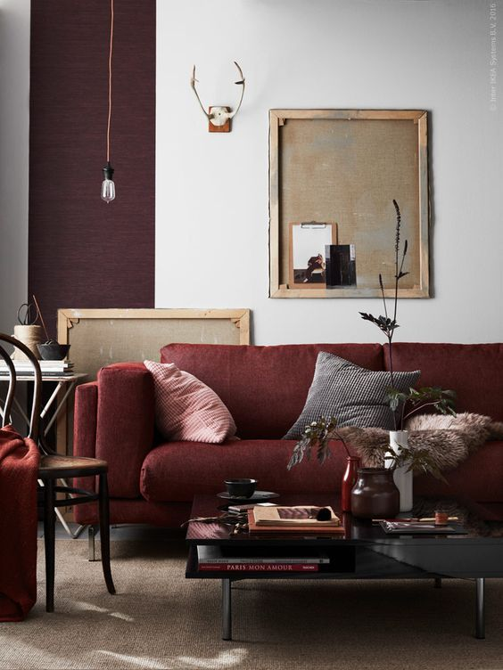 Decorating a neutral living room, with a burgundy couch ...