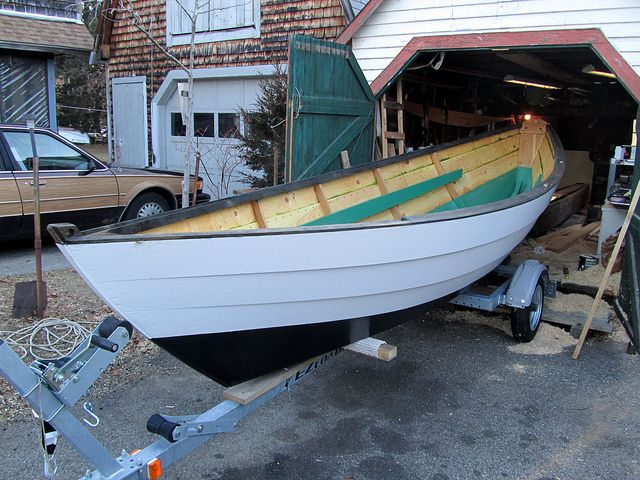"The boat ""Dancing Feather"" is the one I had at my shop for a couple weeks. She has gently rounded sides (less curve than a typical Swampscott) and was built, Im told, in mid coast maine,Dancing feather on a 17+- foot length had a wider bottom than the Alpha at 21' loa. She also has fairly narrow and numerous planks for such a small boat, she does not have the typical tumble home in the sheer strake aft as many Swampscott boats do, and consequently her transom was cr"