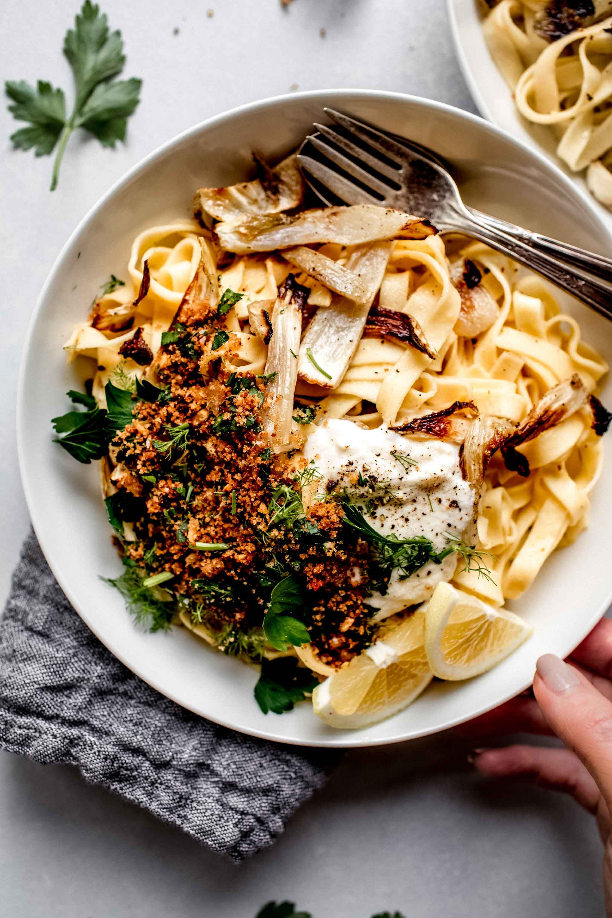 This Roasted Fennel Pasta recipe features fresh linguine tossed in a light lemon sauce with roasted fennel. It's topped with dollop of ricotta cheese for extra richness.
