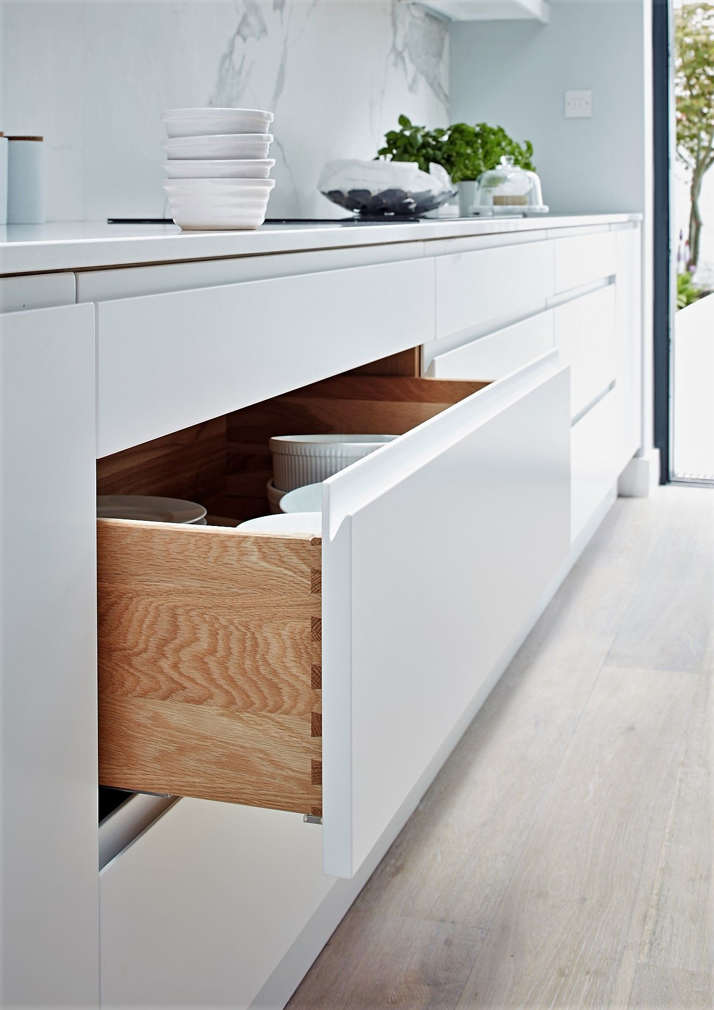 Pure Handleless Kitchen Cabinetry From John Lewis Of Hungerford All Our Ranges Have Traditionally Ma Handleless Kitchen Kitchen Cabinetry Contemporary Kitchen