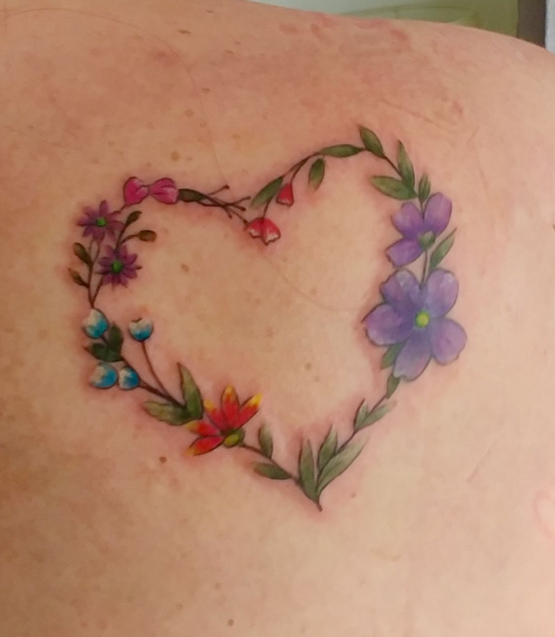 Heart And Flowers Tattoo On Shoulder Heart Flower Tattoo Flower Wrist Tattoos Foot Tattoos