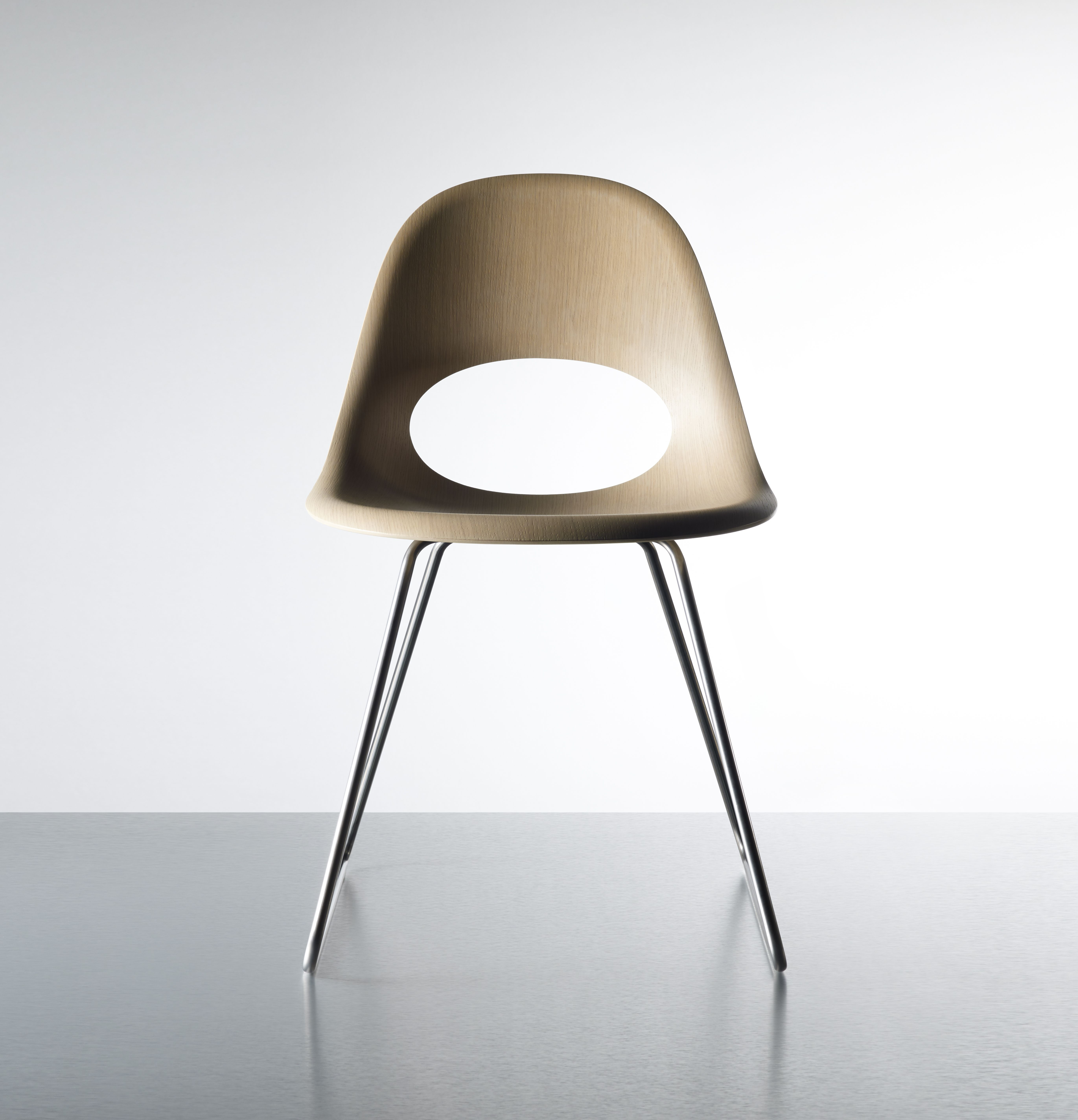 This beautiful SayO MiniLux Chair in raw wood with metal legs seen from the front. May be acquired with different types of wood veneer. Find out more at www.sayo.dk.