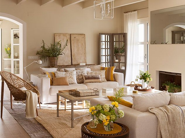 Charming living room done in neutrals with a little pop of for Casas de muebles en barcelona