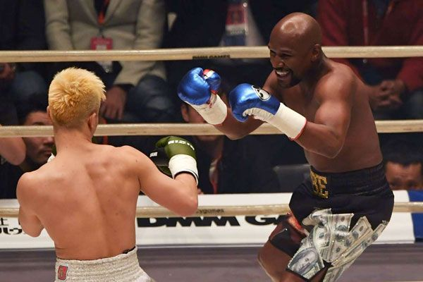 US boxing legend Floyd Mayweather Jr (right) smiles during