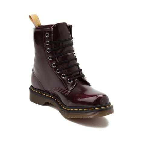Show the environment some love with the Vegan 1460 8-Eye boots from Dr. Martens! Features include a smooth, synthetic leather upper, metal eyelets, Goodyear welted construction, cushioned insole, and signature air cushioned PVC sole. ORDER IN YOUR NORMAL U.S. SIZES.