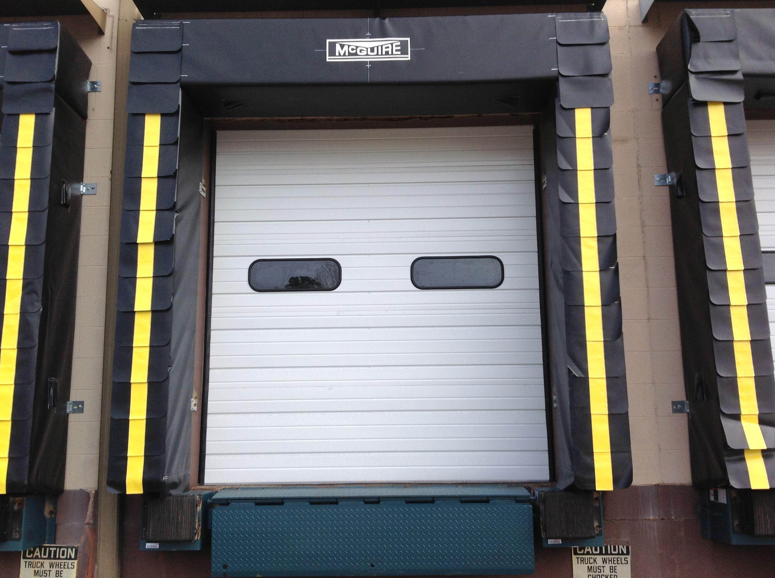 Maguire Sectional Door We Carry And Install Mcguire Doors Www Warehousecubed Com Sectional Door Modular Building Installation