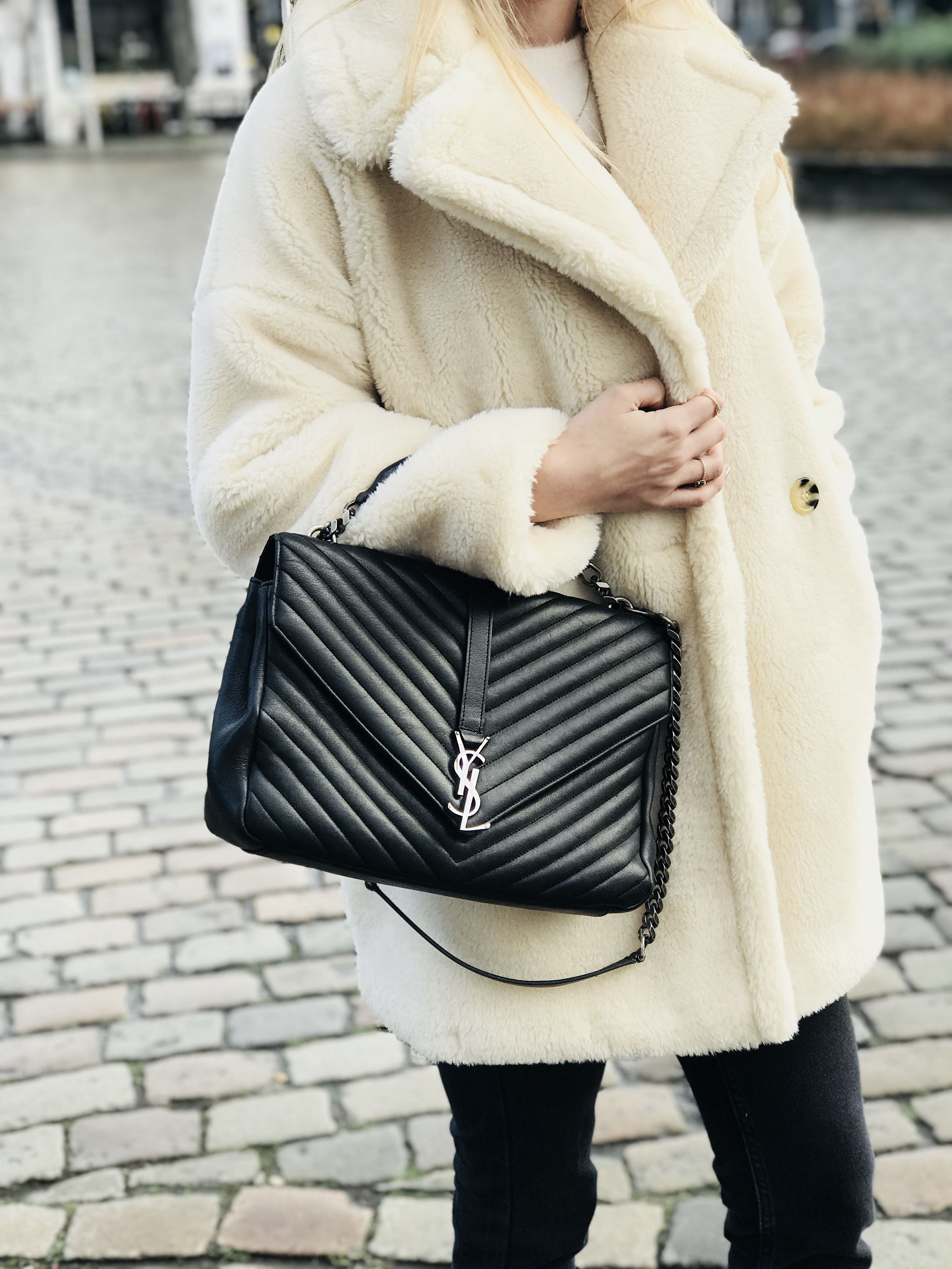 49bcc9f1930b Teddy Coats   Yves Saint Laurent bags for the win! We love this street  style... www.labellov.com