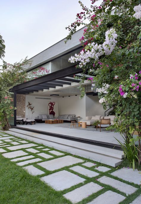 outdoor terrace with pergola and concrete pavers in different sizes