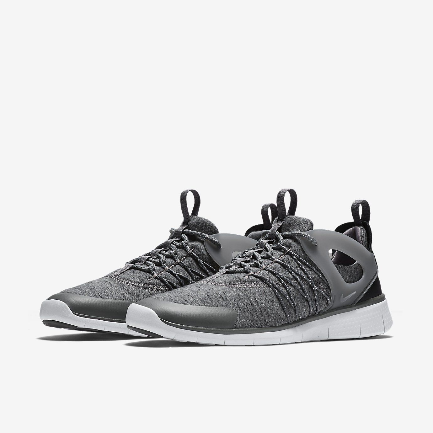 Nike adds its latest running silhouette for women, the Free Viritous in its  Fall/Winter Tech Fleece collection. The pair sports a grey bootie upper co