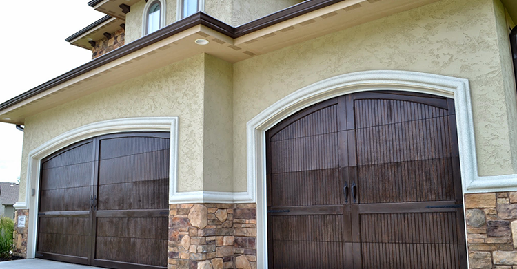 When Designed And Installed Properly A Wooden Garage Door Has The Potential To Transform A House That Has A Garage Doors Wood Garage Doors Wooden Garage Doors