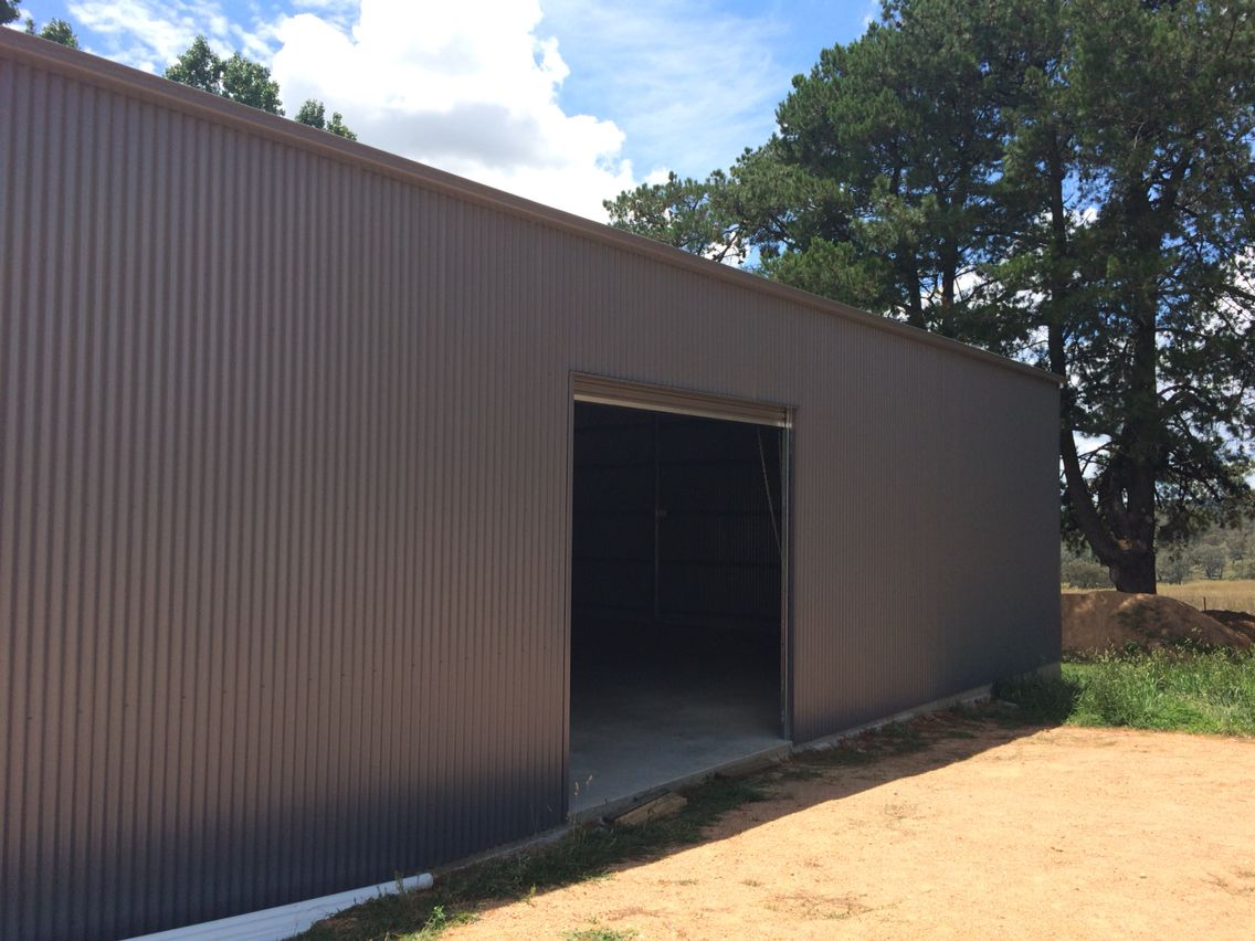 systems garage wide domestic taurean steel in doors homes shed for sheds about door roller and