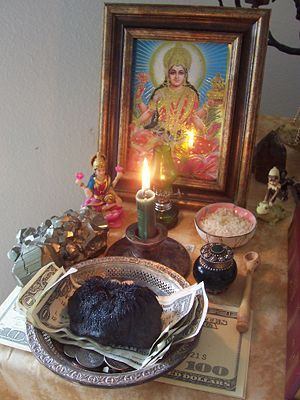 A money-stay-with-me altar prepared for continuing wealth and