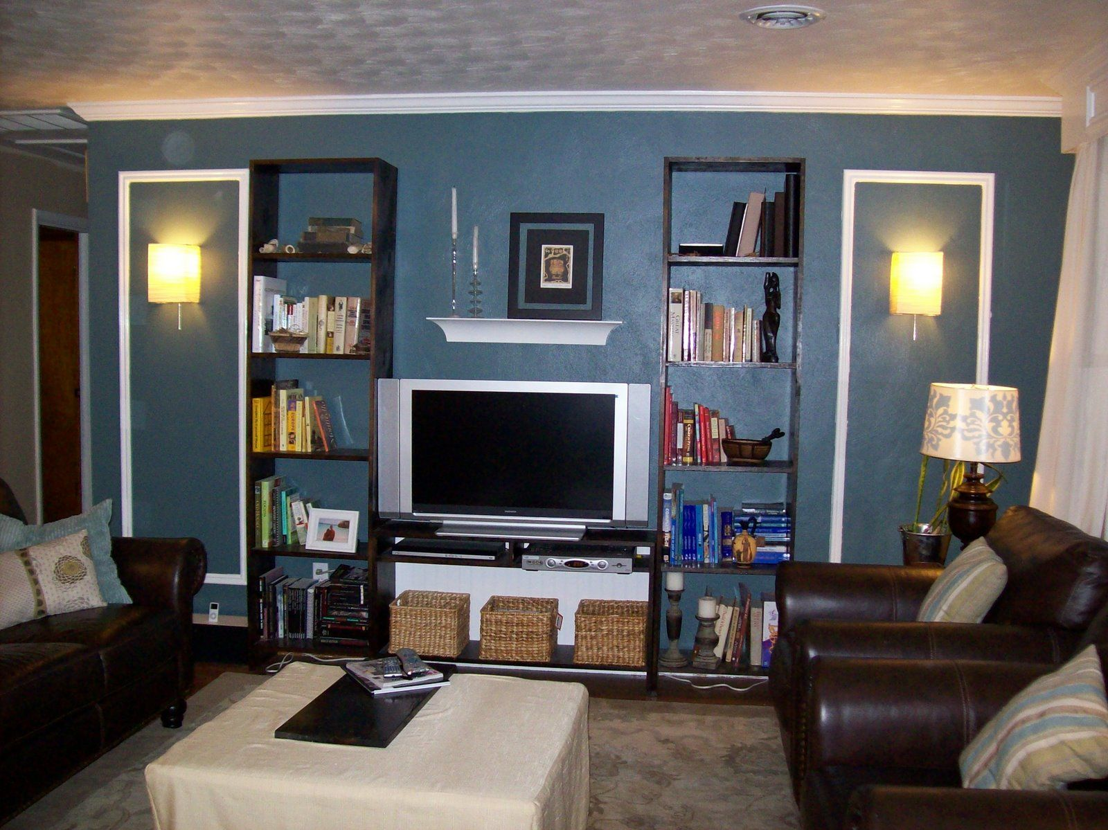 living room in blue%0A We updated our Family Room by adding panel molding and crown molding to the  walls  Molding around the entrance to the dining room  and addi