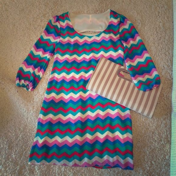 Multi colored chevron dress Sage size small. Blue, green, red, cyan, white, and pink chevron dress. Zips in the back with large key hole design. 100% polyester. Excellent condition. Sage Dresses Mini
