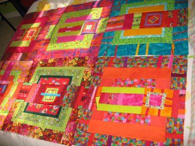"""Melody said """"I put the six completed blocks on my guest bed and saw that they are not going to work as a single quilt. Each block is a quilt in its own right.  I would much rather have them hung on my walls or in a gallery setting than on a bed. A bed quilt is something else...and these are not IT.""""..."""