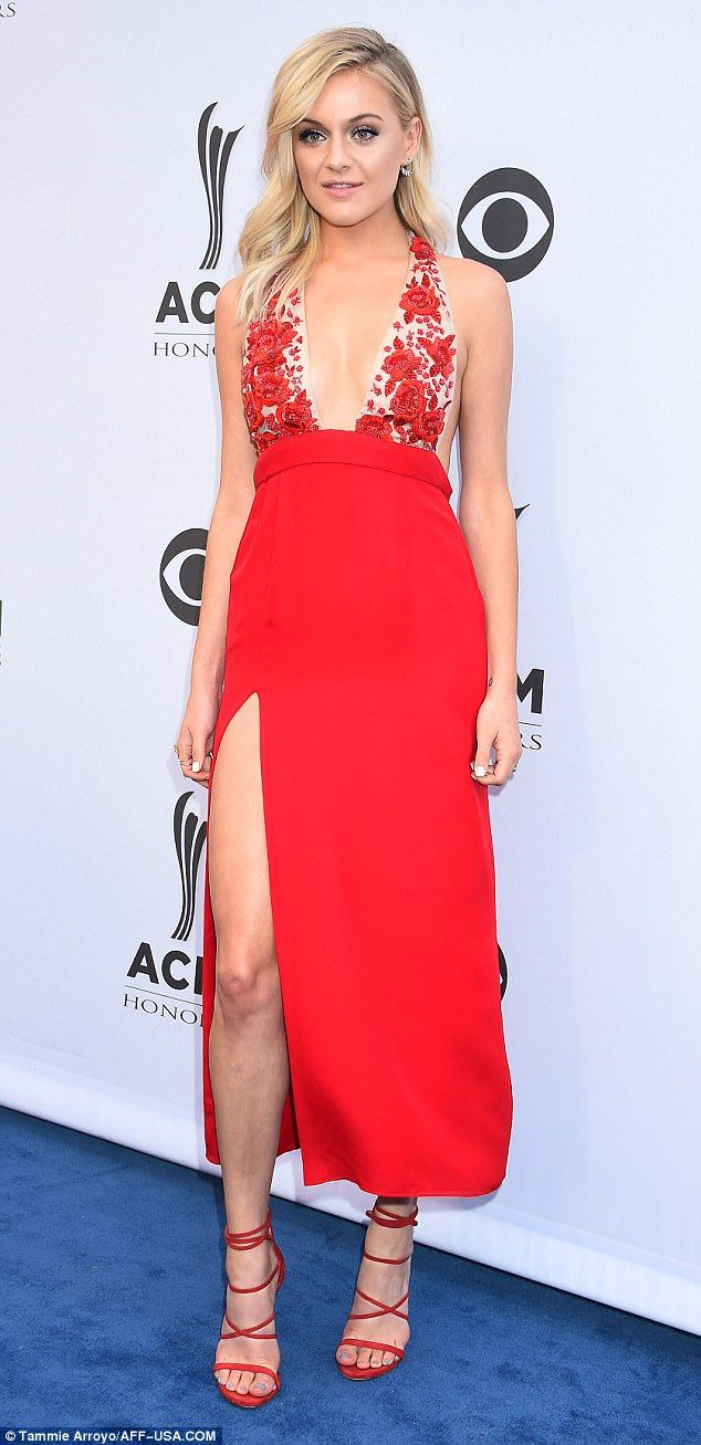 5086367b75892c Star power: Kelsea Ballerini looked ravishing in a red halter neck dress  with plunging neckline and slit skirt at the ACM Honors n Nashville on  Wednesday ...