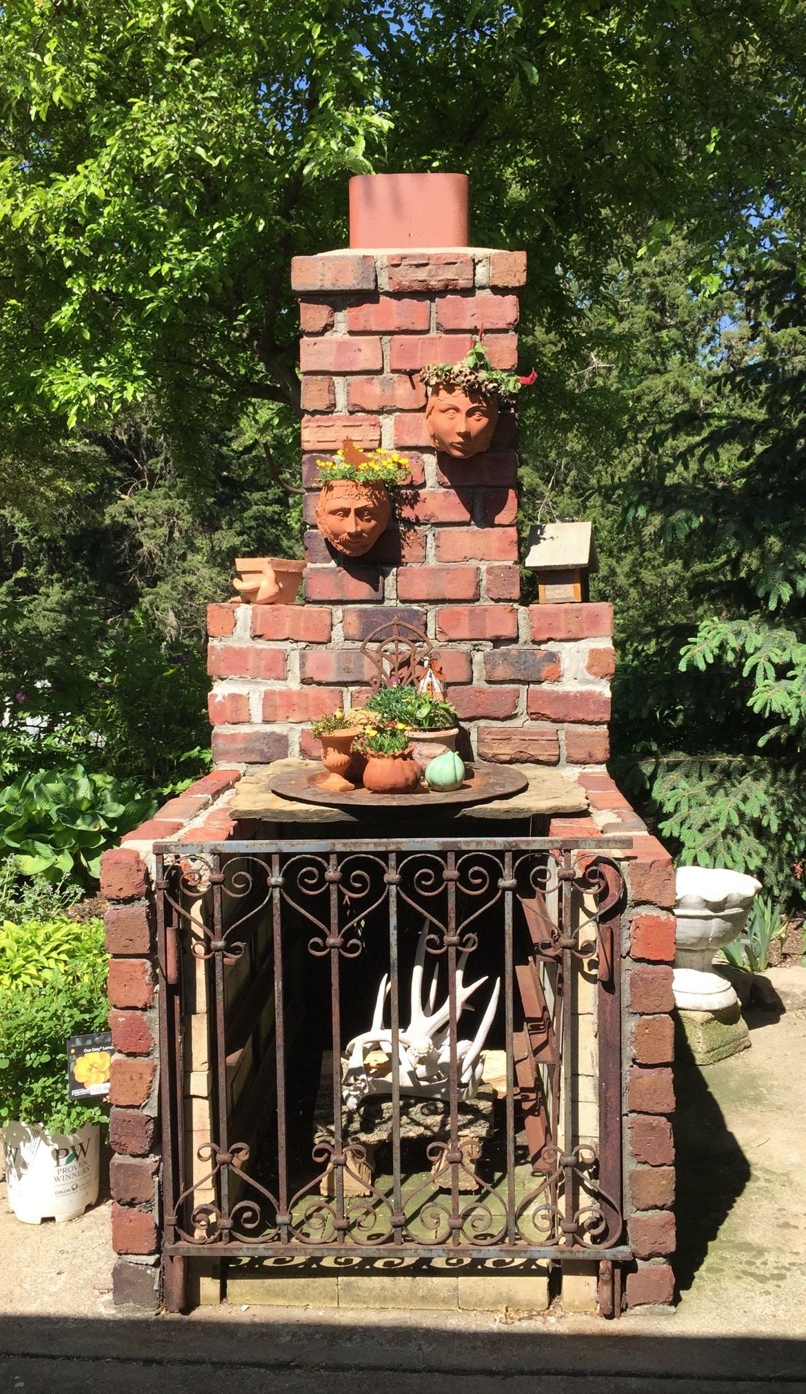 Creative Chiminea Idea Constructed With Bricks And A Vintage Iron Gate In The Red Cedar Country Gardens In Stillw Downloadable Art Country Gardening Art Design