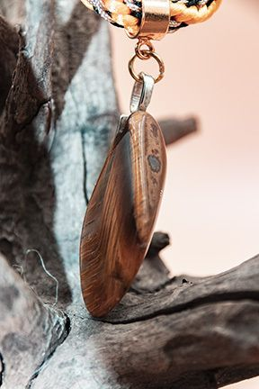 Photo of tigers eye pendant on kumihimo twisted braid