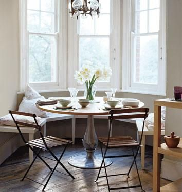 Elegant Harriet Maxwell Macdonald Sweet Cottage Bay Windows Dining Nook Design With  Built In Wood Bench, Round Wood Dining Room Table With Metal Base, Wood  Slatted ...