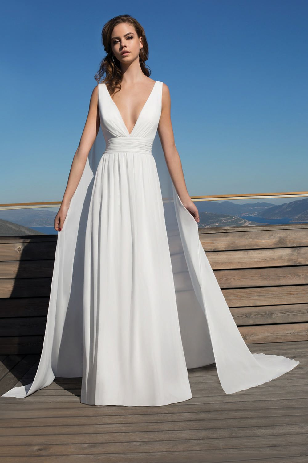 120e5e7fd4 Metropolitan Collection - Wedding Dress Style ME145 : This flowing, Grecian  inspired Chiffon A-line gown features a plunging V-neckline, sexy low back  and ...