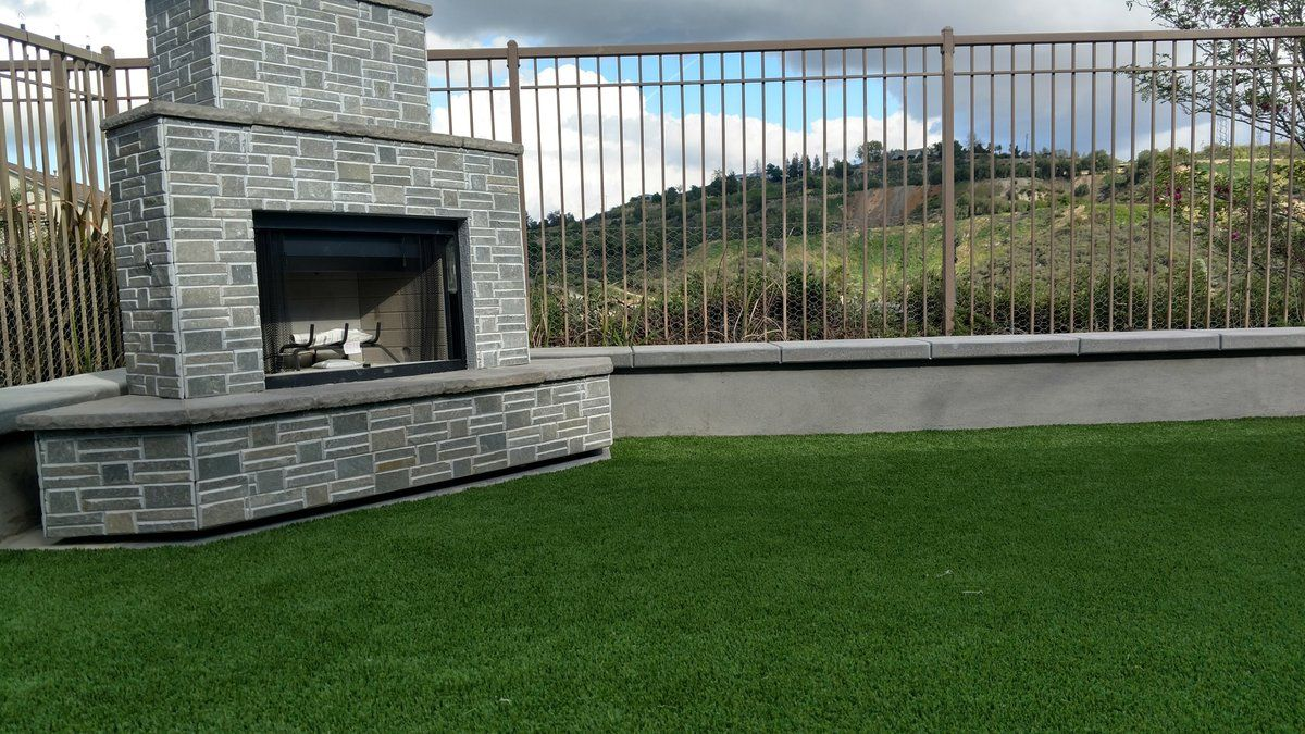 ProLawn Turf - outdoor fireplace and artificial turf.