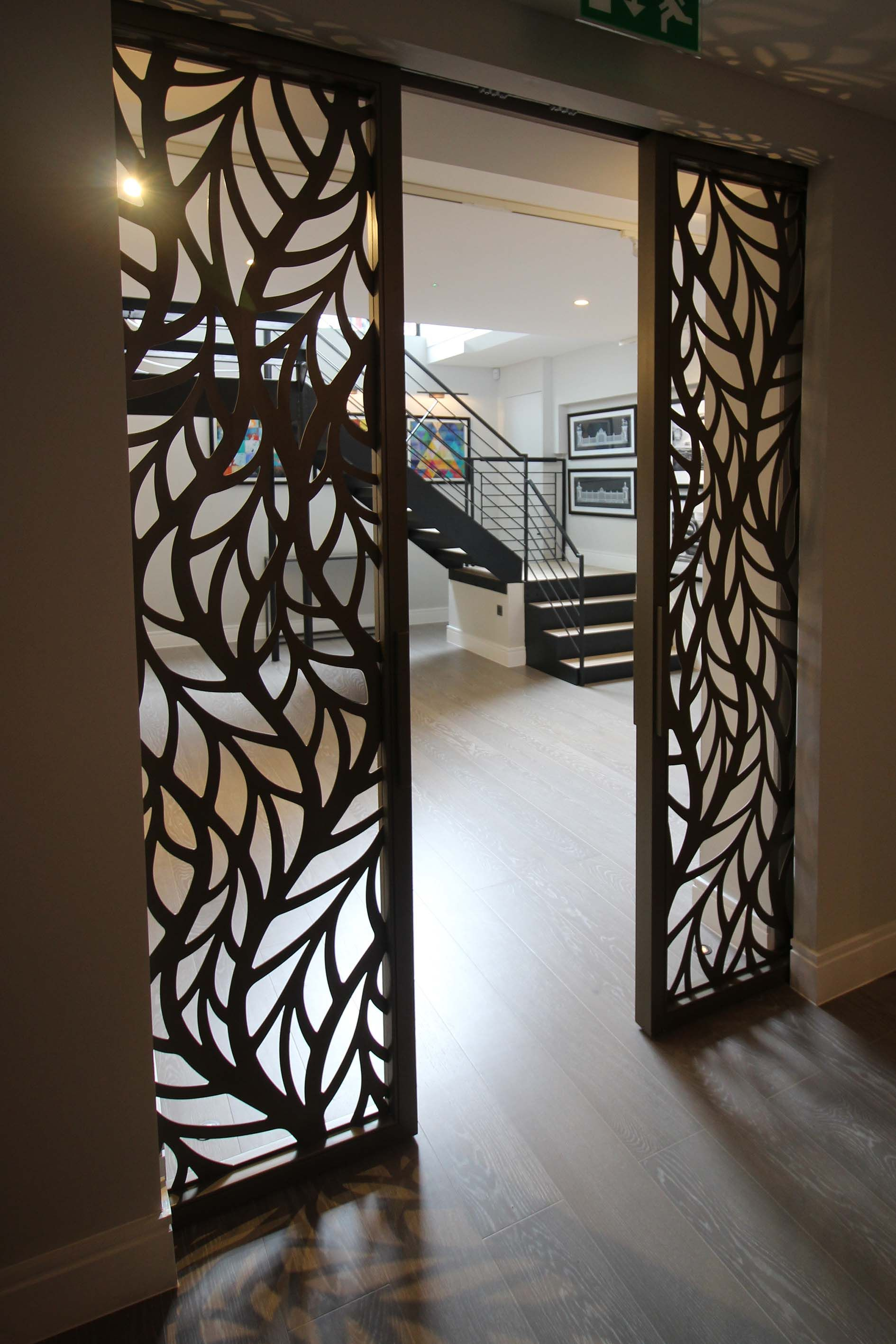 Silian art gallery london laser cut sliding doors frond for Sliding glass doors nyc