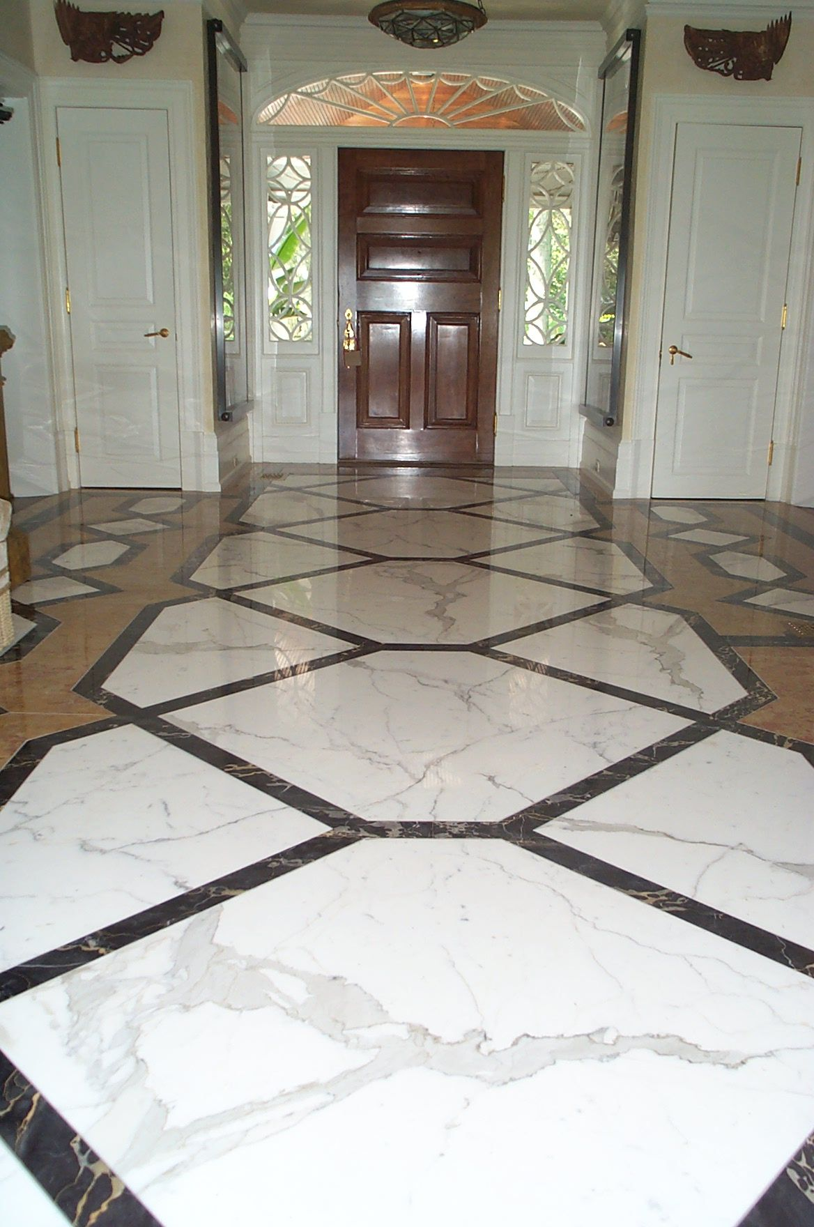 This stunning entryway features Calacatta White Portoro