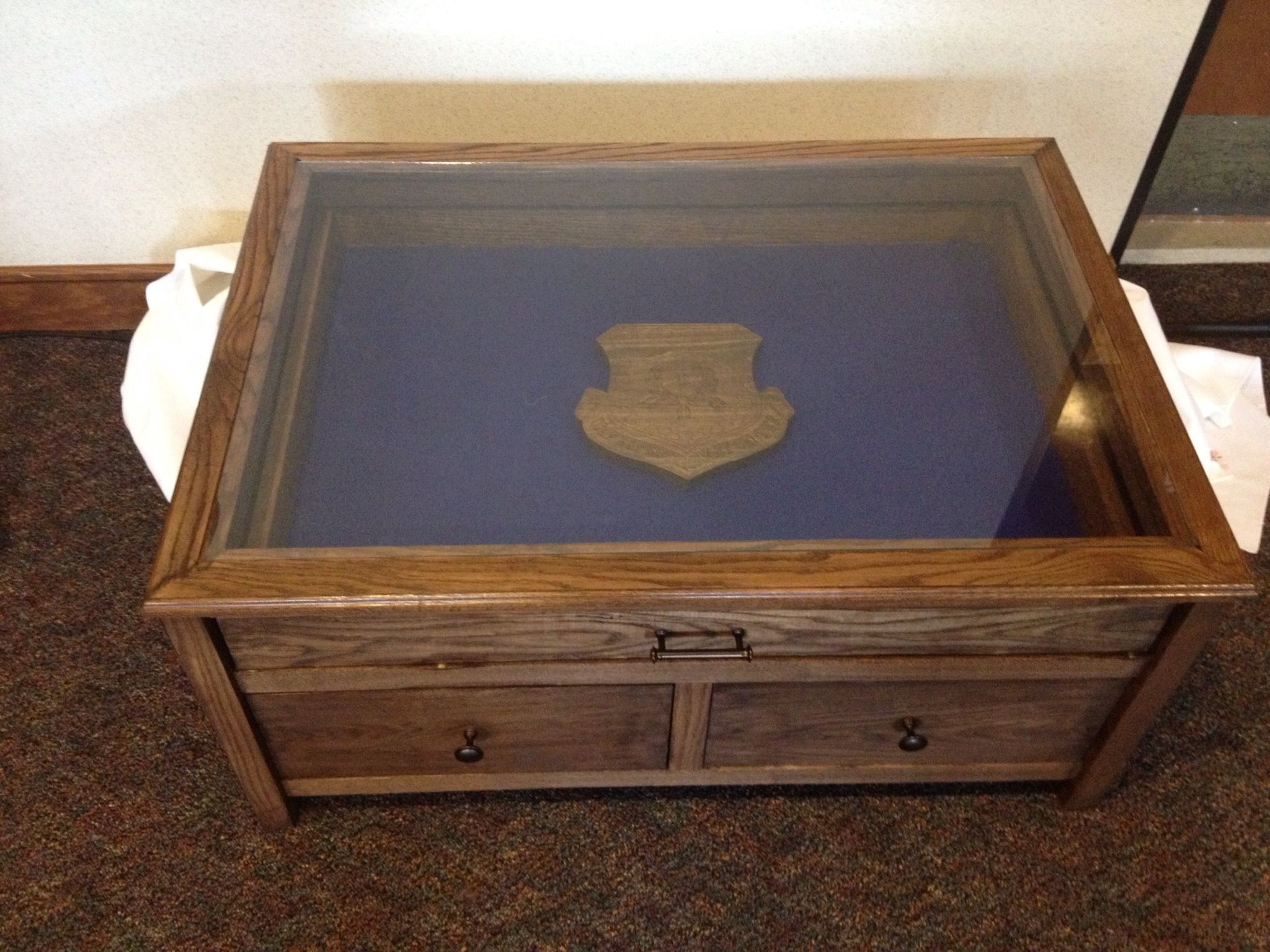 Glass top coffee table to display military coins