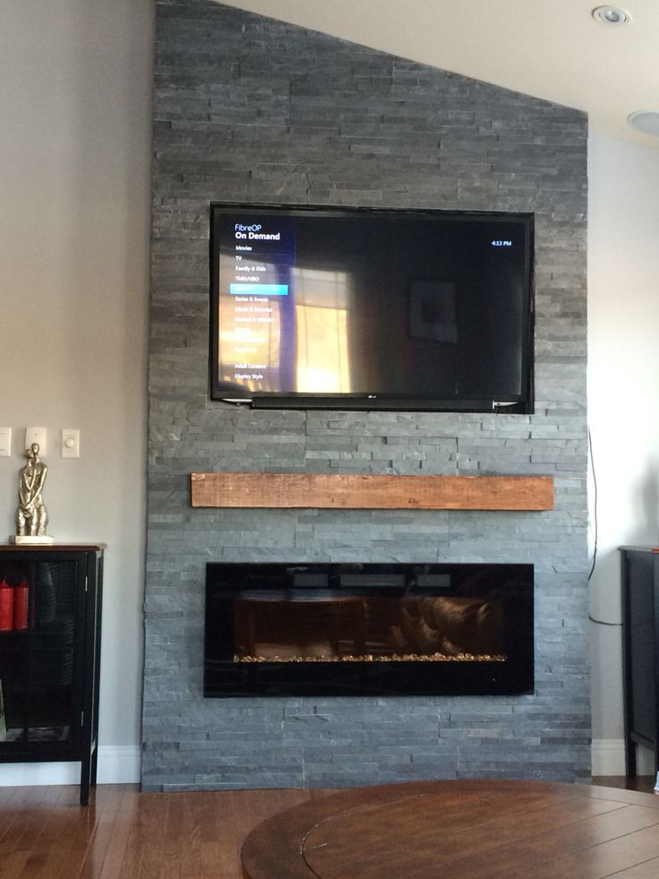 Grey stone fireplace with floating mantle electric for Fireplace wall