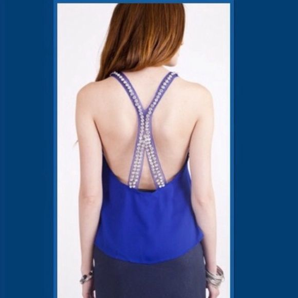 HP Racer back top Umgee fits true to size Loose cut top, perfect for lounging, casual barbecue day high/low top. Royal blue coloring on the front with orange stripes on the back to show just a little extra classy sexy skin. 55% cotton. 45% polyester Umgee Tops
