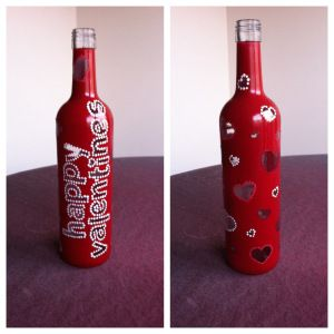 Valentine S Day Themed Hand Painted Wine Bottles Fill With Some Homemade Sangr Valentines Wine Bottle Crafts Valentines Wine Bottles Hand Painted Wine Bottles