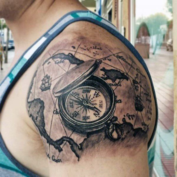 50 world map tattoo designs for men adventure the globe tattoo upper arm shoulder mens world map tattoos with compass gumiabroncs Images