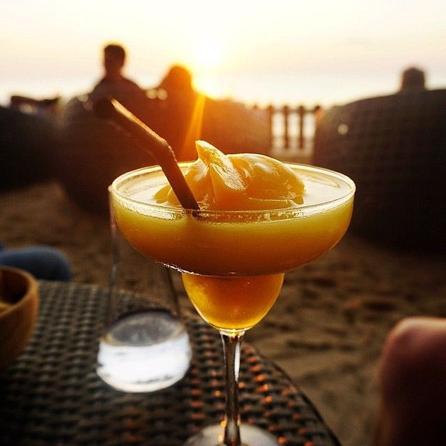 We at #rockbarbali loves to treat you with an exotic frozen cocktail while you wait for the real treat of the #sunset!  Photo by @joborrello_
