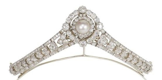 A diamond and pearl tiara, circa 1880. Two flanking diamond motifs supporting a central large pearl surrounded by a double band of diamonds. Sold by Bonhams in December 2012 for £30,000.