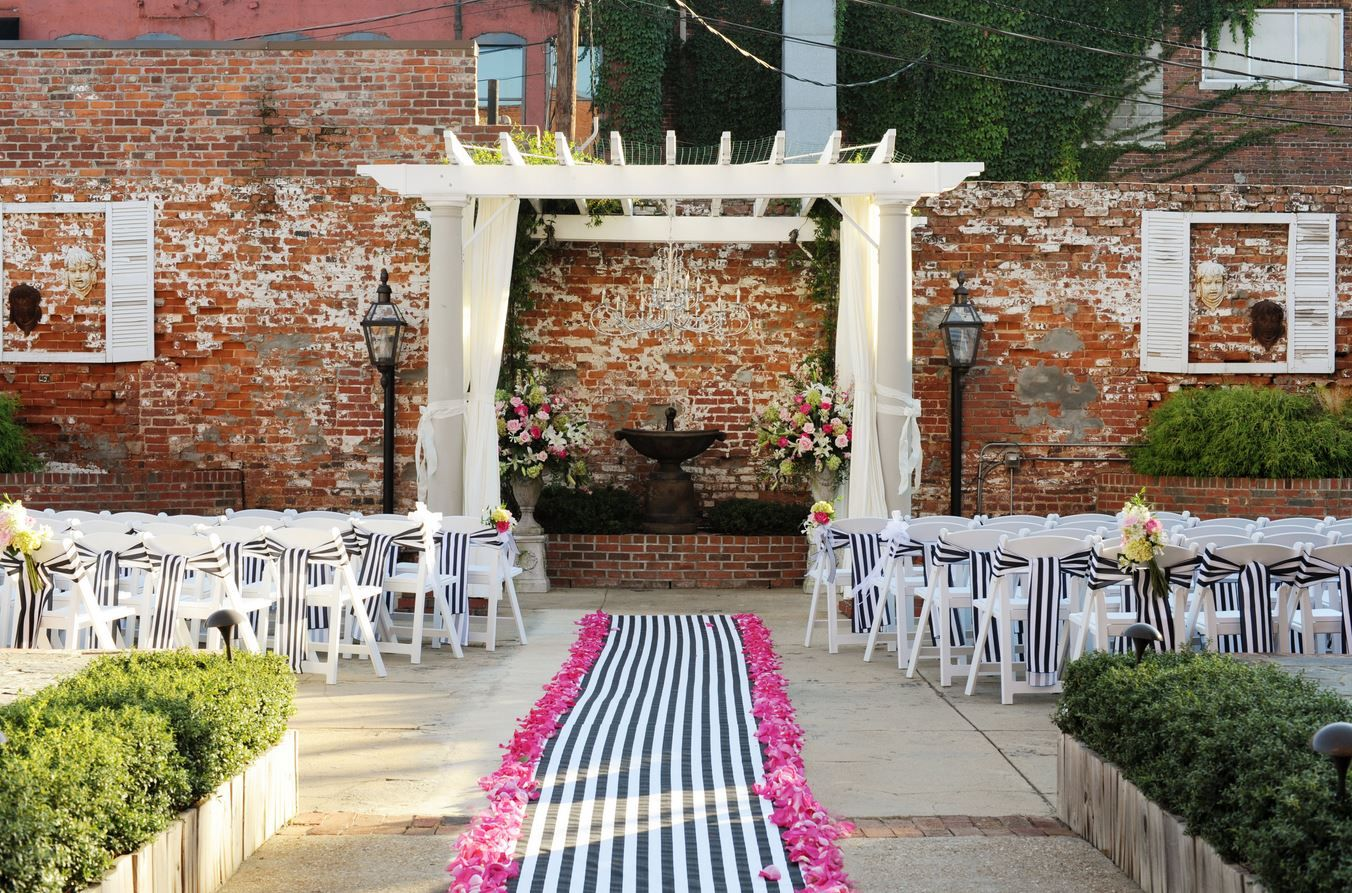 Black and white wedding decor ideas  Black and white stripe aisle runner and chair sashes  Beautiful