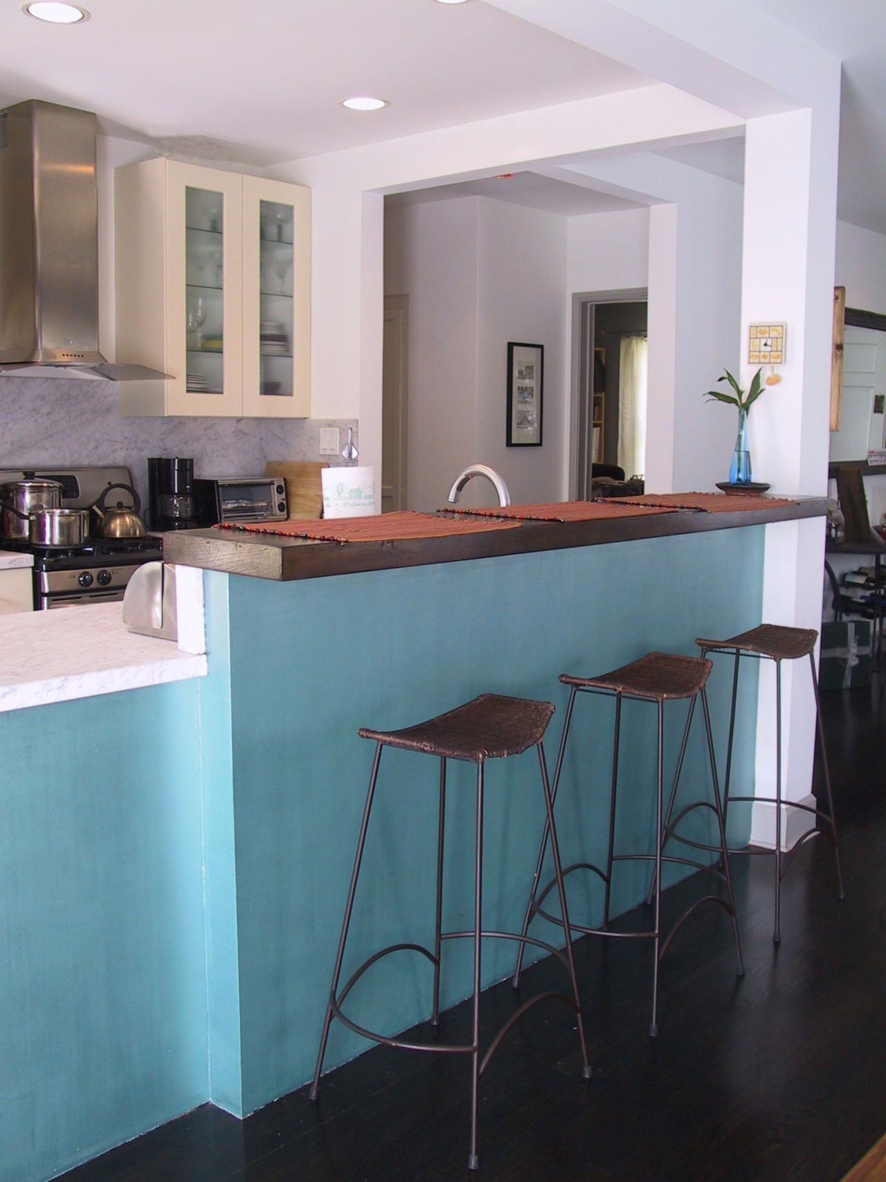 Three metal barstools sit at a kitchen counter bar painted a cheery ...