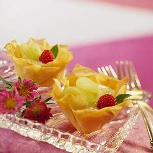 Melon & Cream Tartlets  Slices of honeydew melon and melon liqueur make these rich and creamy phyllo tarts delectable. To make paper-thin ribbons of melon, use a vegetable peeler to scrape lengthwise strips.