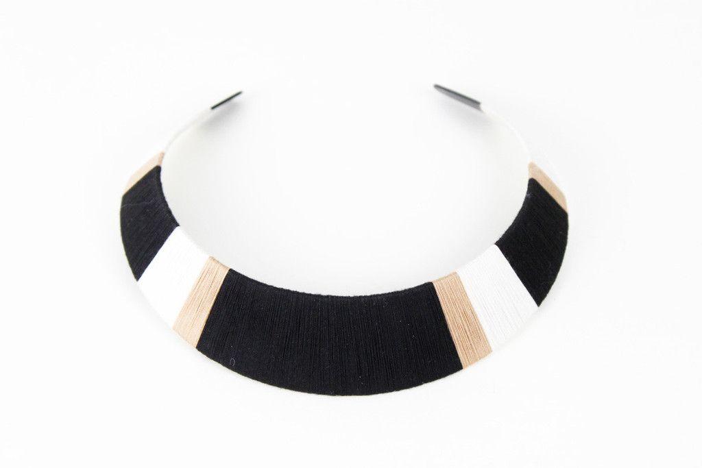 thread-wrapped bib necklace.