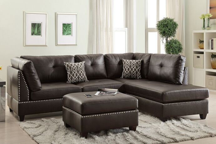 This Set Includes The 2 Pc Reversible Chaise Sectional Sofa With Throw  Pillows And Ottoman.
