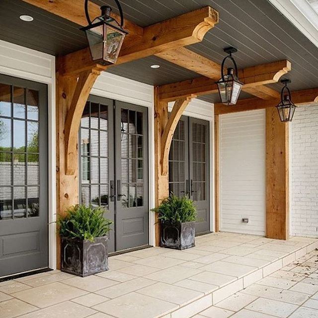 This porch i saw on homebunch is stunning dont you think benjamin moore chelsea gray garage door love this color with white and the wood beams do trellis in wood over garage and paint garage door gray planetlyrics Image collections