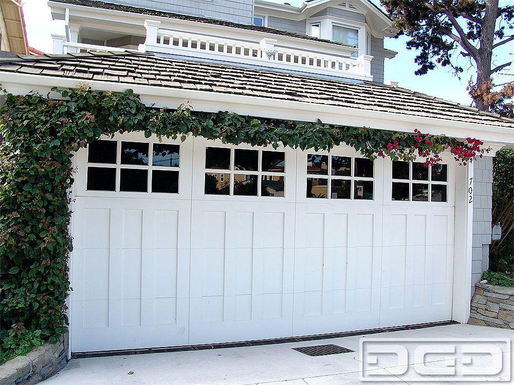 Traditional carriage house garage doors combined with for Garage doors designs