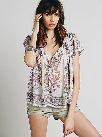 91bcb5983ab FP One Short Sleeve Printed Peasant Top   Lightweight and sheer floral  printed peasant top featuring button closures down the front. Raw trim.