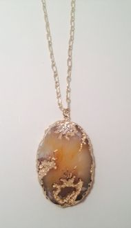 This is a customer favorite! Everyone will stop you wanting see this Etched Stone Necklace! Stunning stone with gold in-lay Purchase today for ONLY $19! www.thejewelledbee.com
